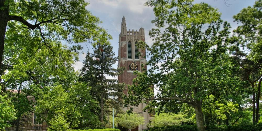 Michigan State University Beaumont Tower in the summer surrounded by green trees