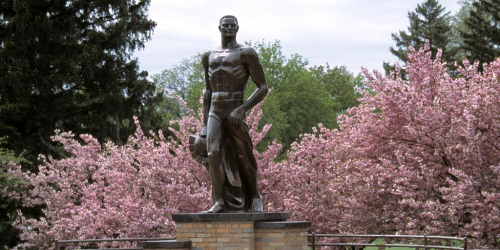 Michigan State University Sparty statue with spring flowers